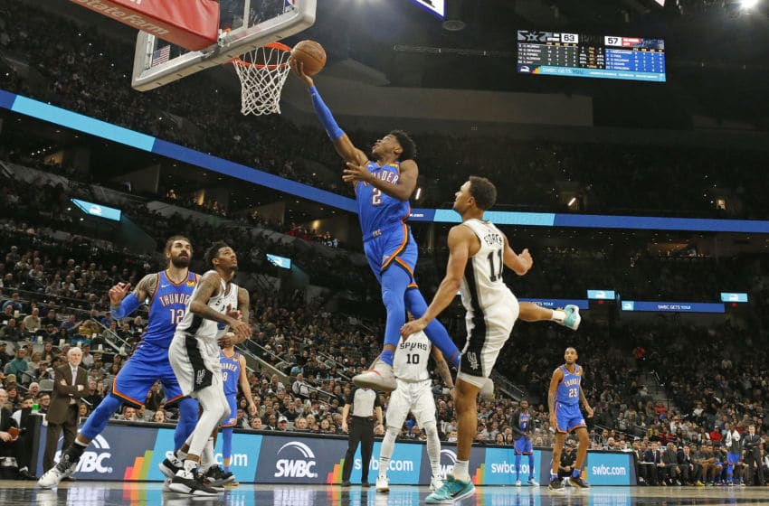 Shai Gilgeous-Alexander #2 of the OKC Thunder flies past Bryn Forbes #11 of the Spurs (Photo by Ronald Cortes/Getty Images)