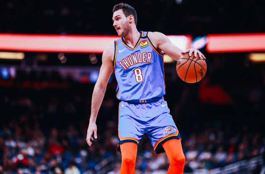 JANUARY 22: OKC Thunder's Danilo Gallinari #8 controls the ball against the Orlando Magic (Photo by Harry Aaron/Getty Images)