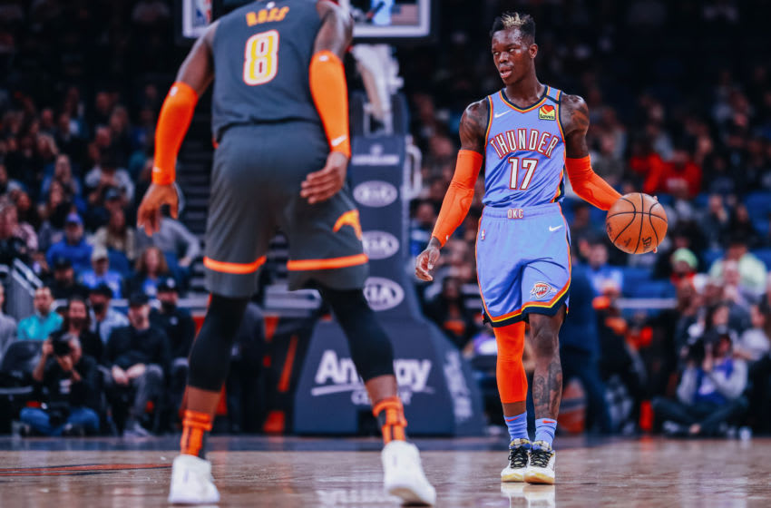 JANUARY 22: Dennis Schröder #17 of the OKC Thunder in control of the ball against Terrence Ross #8 of the Orlando Magic (Photo by Harry Aaron/Getty Images)