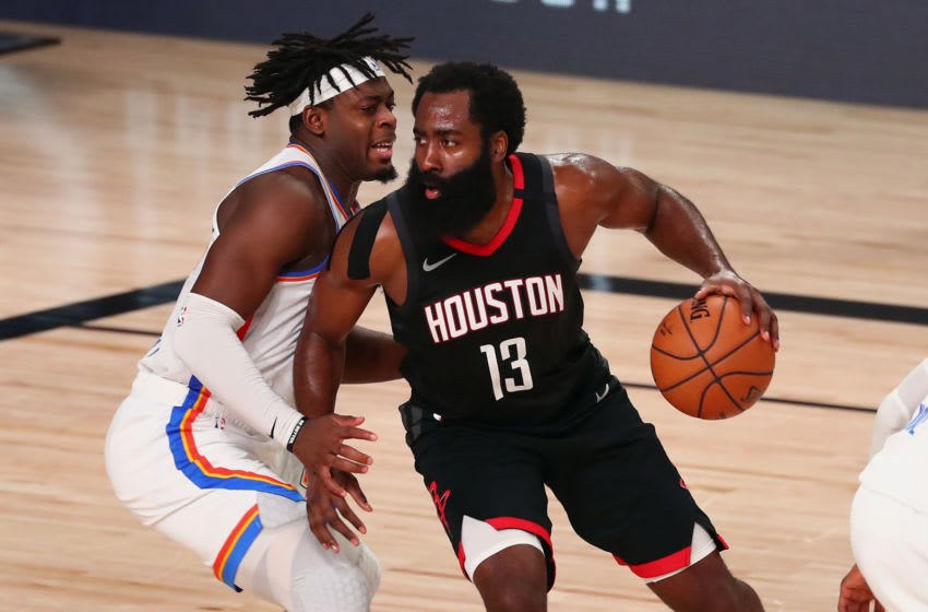 AUGUST 24: James Harden #13 of the Houston Rockets dribbles against Luguentz Dort #5 of the OKC Thunder. (Photo by Kim Klement-Pool/Getty Images)