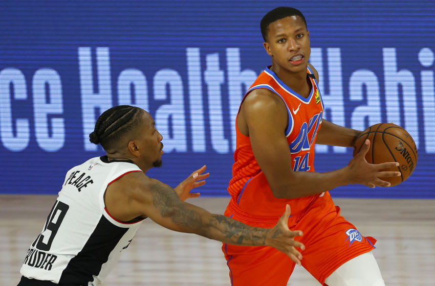 Devon Hall #14 of the OKC Thunder drives the ball against Rodney McGruder #19 of the LA Clippers during the third quarter (Photo by Mike Ehrmann/Getty Images)