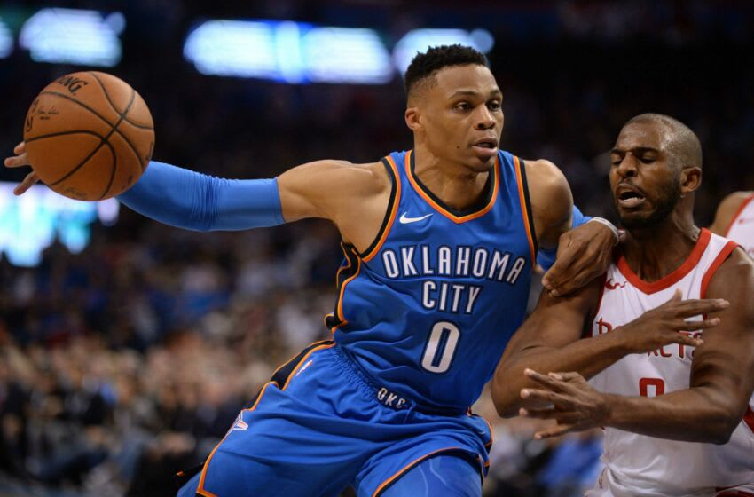 OKC Thunder guard Russell Westbrook (0) drives to the basket against guard Chris Paul (3): Mark D. Smith-USA TODAY Sports