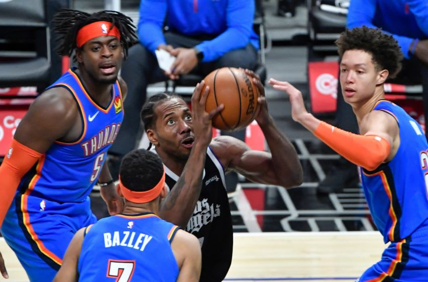 Clippers forward Kawhi Leonard (2) moves to the basket between OKC Thunder forward Luguentz Dort (5), Darius Bazley (7) and Isaiah Roby (22): Robert Hanashiro-USA TODAY Sports