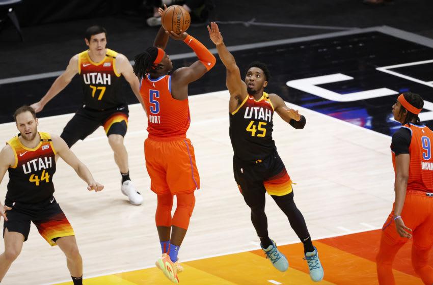 OKC Thunder forward Luguentz Dort (5) shoots over Utah Jazz guard Donovan Mitchell : Jeffrey Swinger-USA TODAY Sports