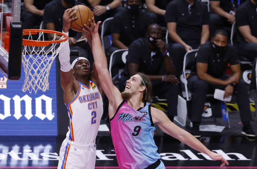 Miami Heat forward Kelly Olynyk (9) is defended by OKC Thunder guard Shai Gilgeous-Alexander (2): Rhona Wise-USA TODAY Sports