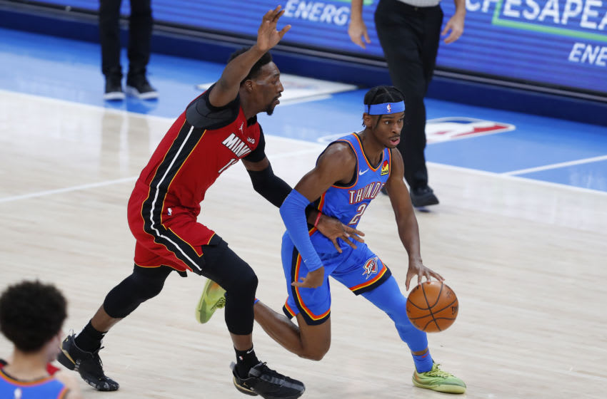 OKC Thunder guard Shai Gilgeous-Alexander (2) drives to the basket around Miami Heat center Bam Adebayo (13). Mandatory Credit: Alonzo Adams-USA TODAY Sports.