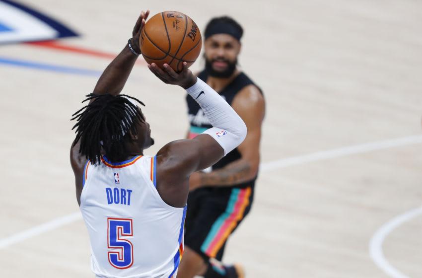 OKC Thunder forward Luguentz Dort (5) shoots the game winning basket as San Antonio Spurs: Alonzo Adams-USA TODAY Sports