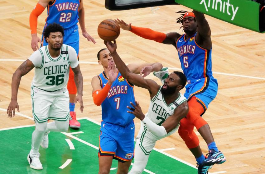 OKC Thunder forward Luguentz Dort (5) and forward Darius Bazley (7) defend against Boston Celtics guard Jaylen Brown (7) : David Butler II-USA TODAY Sports