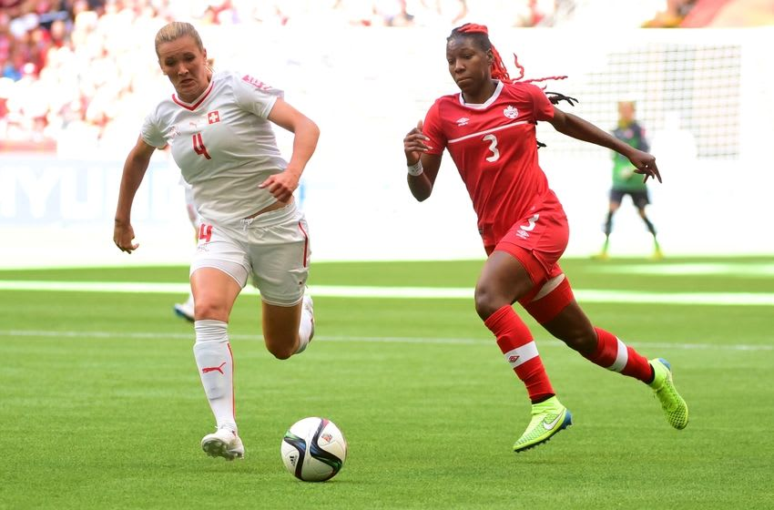 Jun 21, 2015; Vancouver, British Columbia, CAN; Switzerland defender Rachel Rinast (4) and Canada defender Kadeisha Buchanan (3) chase a ball in the first half of a game in the round of sixteen in the FIFA 2015 women's World Cup soccer tournament at BC Place Stadium. Mandatory Credit: Anne-Marie Sorvin-USA TODAY Sports