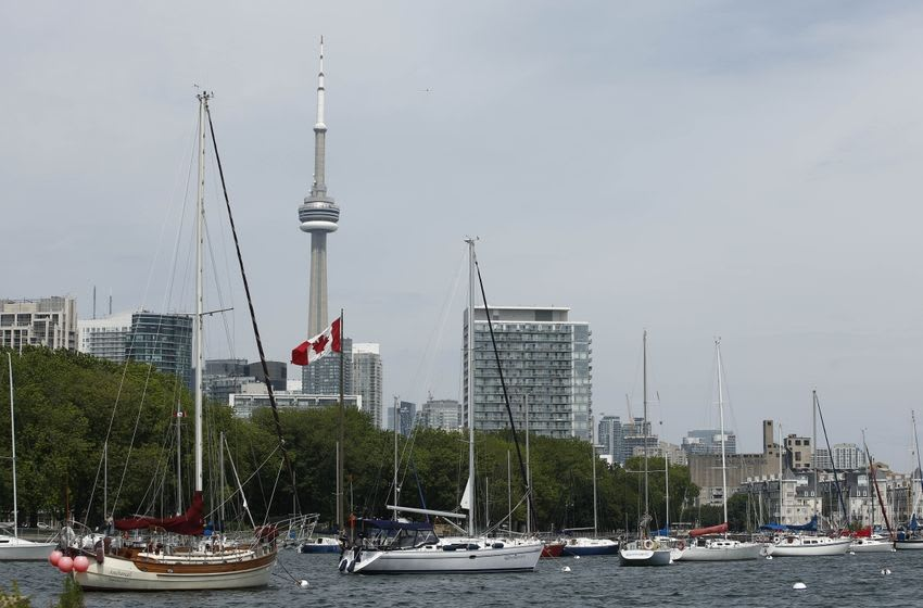 Jul 9, 2015; Toronto, Ontario, Canada; General view of boats docked in the National Yacht Club with the CN Tower in the background in preparation for the 2015 Pan Am Games. Mandatory Credit: Rob Schumacher-USA TODAY Sports