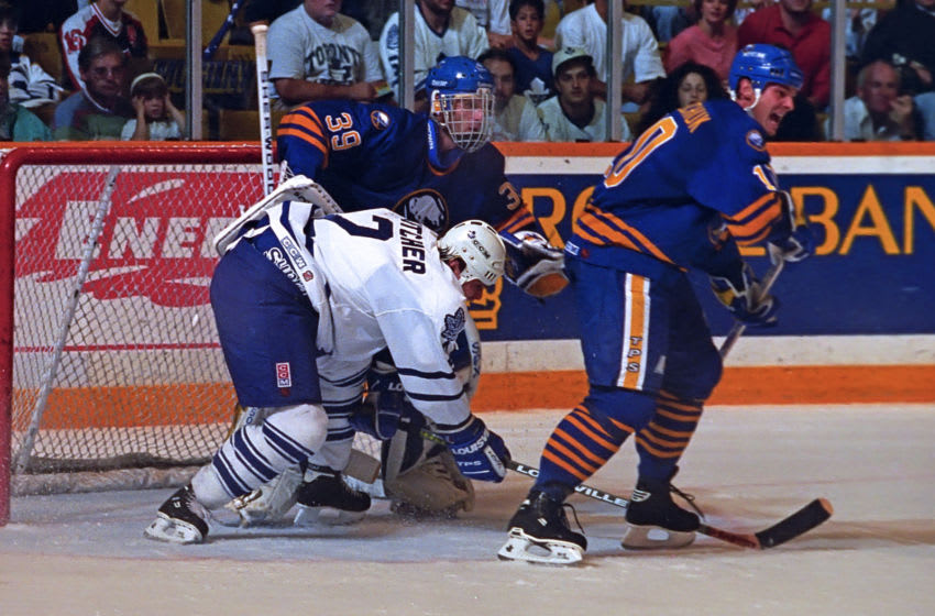 Garth Butcher #2 of the Toronto Maple Leafs, Dale Hawerchuk #10 and Dominik Hasak #29 of the Buffalo Sabres. (Photo by Graig Abel/Getty Images)