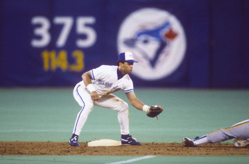 Roberto Alomar #12 of the Toronto Blue Jays in action during a Major League Baseball game circa 1992 at Exhibition Stadium in Toronto. (Photo by Focus on Sport/Getty Images)