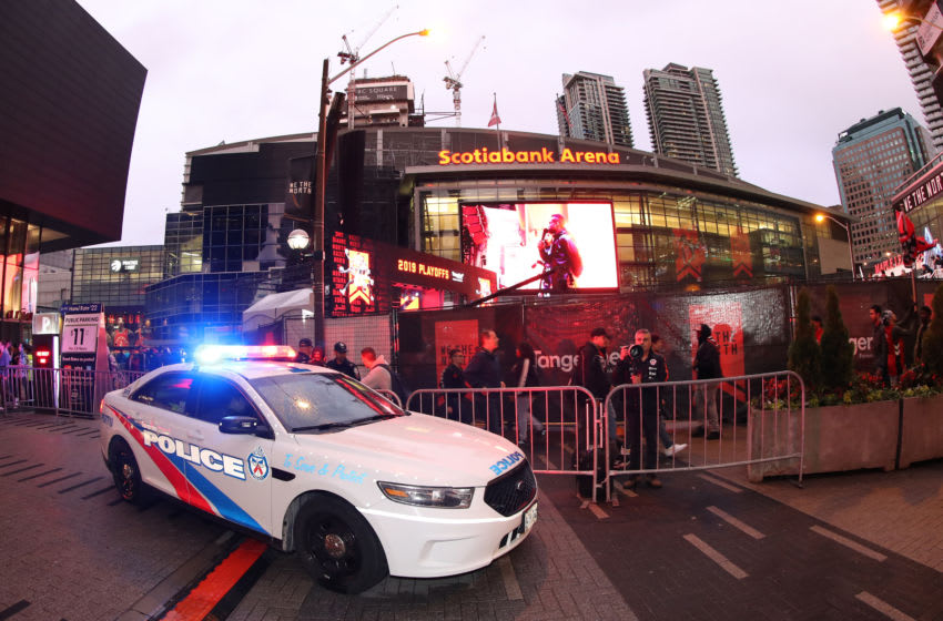 Police provide security outside the arena as fans gather at Jurassic Park at Scotiabank Arena. (Photo by Tom Szczerbowski/Getty Images)