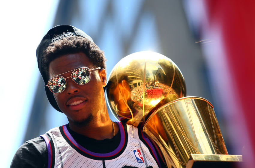 Kyle Lowry #7 of the Toronto Raptors holds the championship trophy during the Toronto Raptors Victory Parade on June 17, 2019 in Toronto, Canada. The Toronto Raptors beat the Golden State Warriors 4-2 to win the 2019 NBA Finals. (Photo by Vaughn Ridley/Getty Images)