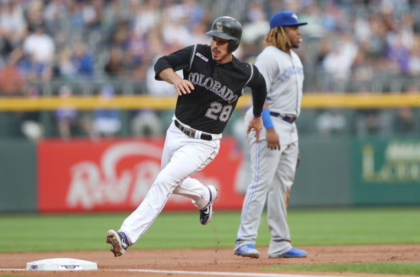 Nolan Arenado #28 of the Colorado Rockies rounds the bases to score on a Daniel Murphy 2 RBI double in the first inning against the Toronto Blue Jays at Coors Field. (Photo by Matthew Stockman/Getty Images)