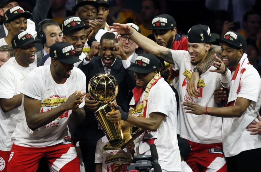 Kawhi Leonard #2 of the Toronto Raptors celebrates with the Larry O'Brien Championship Trophy. (Photo by Lachlan Cunningham/Getty Images)