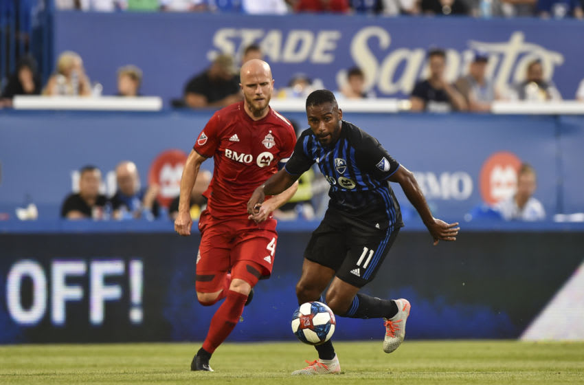 Anthony Jackson-Hamel of the Montreal Impact and Michael Bradley of Toronto FC. (Photo by Minas Panagiotakis/Getty Images)
