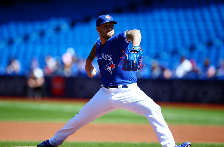 Sean Reid-Foley #54 of the Toronto Blue Jays delivers a pitch in the first inning during an MLB game. (Photo by Vaughn Ridley/Getty Images)