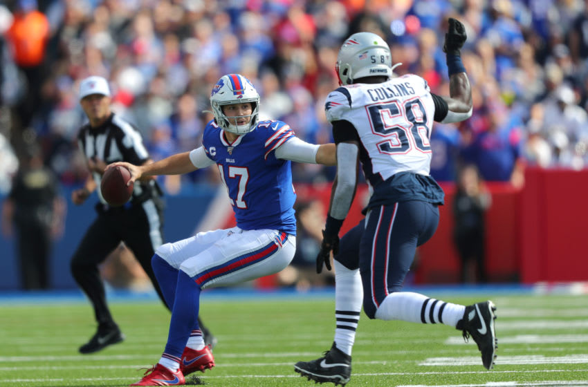 Jamie Collins #58 of the New England Patriots looks to sack Josh Allen #17 of the Buffalo Bills as he looks to throw the ball during the first half at New Era Field. (Photo by Timothy T Ludwig/Getty Images)