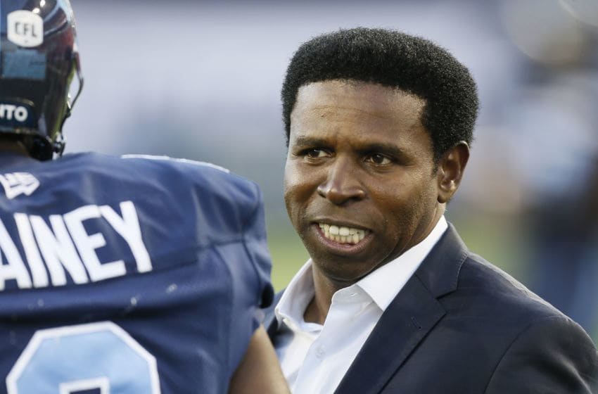 General Manager Michael Clemons of the Toronto Argonauts talks to a player prior to a game against the Ottawa RedBlacks at BMO Field. (Photo by John E. Sokolowski/Getty Images)