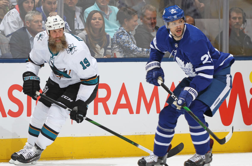 Joe Thornton #19 of the San Jose Sharks skates against Kevin Gravel #25 of the Toronto Maple Leafs during an NHL game at Scotiabank Arena. (Photo by Claus Andersen/Getty Images)