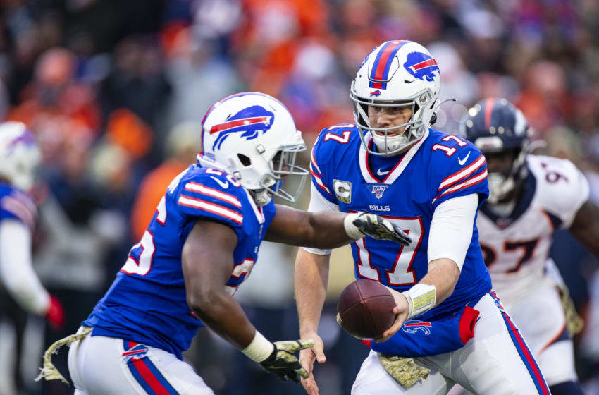 Josh Allen #17 hands the ball off to Devin Singletary #26 of the Buffalo Bills during the third quarter against the Denver Broncos at New Era Field. (Photo by Brett Carlsen/Getty Images)
