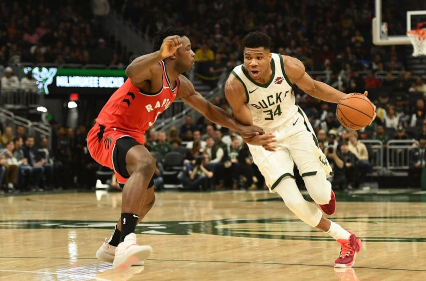 Giannis Antetokounmpo #34 of the Milwaukee Bucks drives around OG Anunoby #3 of the Toronto Raptors during a game at Fiserv Forum. (Photo by Stacy Revere/Getty Images)