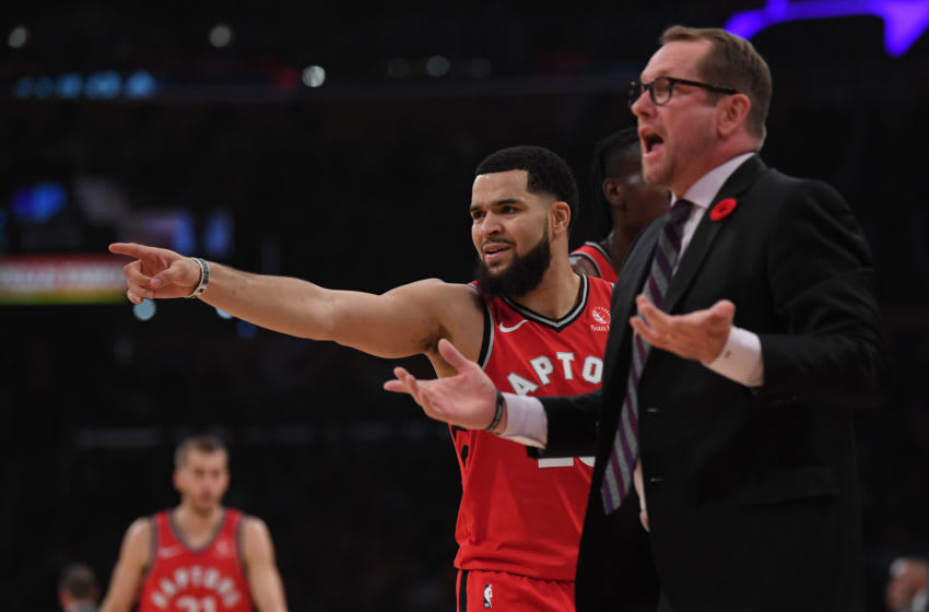Fred VanVleet #23 of the Toronto Raptors and head coach Nick Nurse argue for a foul. (Photo by Harry How/Getty Images)