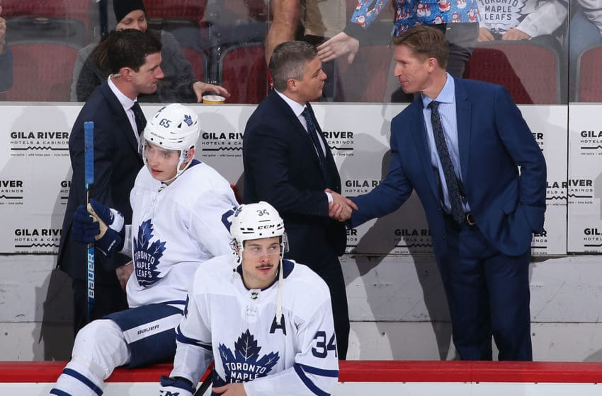Head coach Sheldon Keefe (C) of the Toronto Maple Leafs shakes hands with assistant coach Dave Hakstol after defeating the Arizona Coyotes in the NHL game at Gila River Arena. (Photo by Christian Petersen/Getty Images)