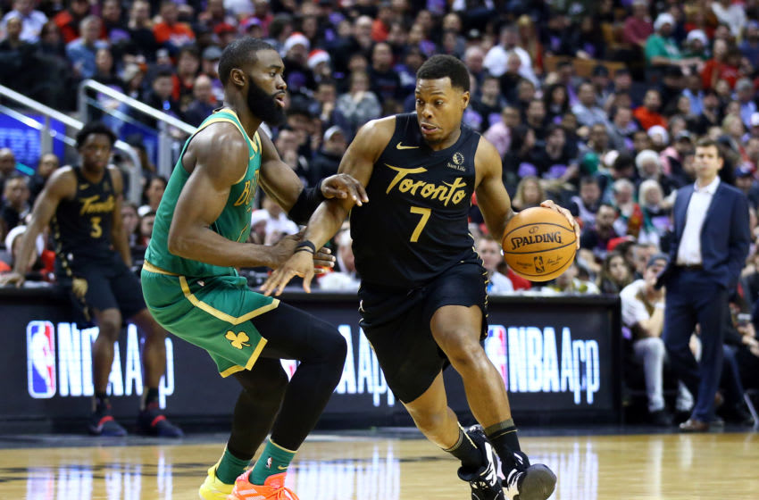 TORONTO, ON - DECEMBER 25: Kyle Lowry #7 of the Toronto Raptors dribbles the ball as Jaylen Brown #7 of the Boston Celtics defends during the second half of an NBA game at Scotiabank Arena on December 25, 2019 in Toronto, Canada. NOTE TO USER: User expressly acknowledges and agrees that, by downloading and or using this photograph, User is consenting to the terms and conditions of the Getty Images License Agreement. (Photo by Vaughn Ridley/Getty Images)