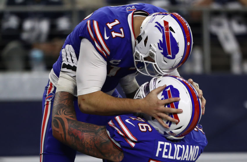Josh Allen #17 of the Buffalo Bills celebrates a touchdown with Jon Feliciano #76 against the Dallas Cowboys in the second half at AT&T Stadium. (Photo by Ronald Martinez/Getty Images)