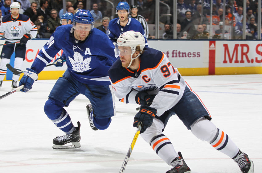 Connor McDavid #97 of the Edmonton Oilers swings around Morgan Rielly #44 of the Toronto Maple Leafs for a goal during an NHL game at Scotiabank Arena. (Photo by Claus Andersen/Getty Images)