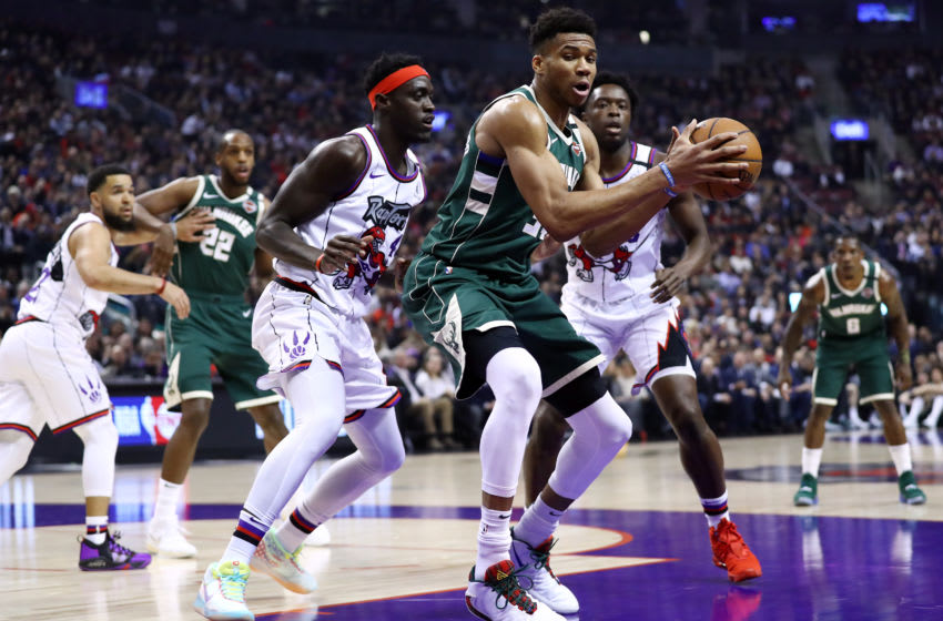 Giannis Antetokounmpo of the Milwaukee Bucks and Pascal Siakam of the Toronto Raptors. (Photo by Vaughn Ridley/Getty Images)