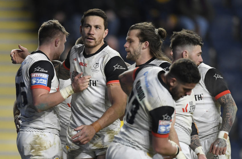 Jack Wells of Toronto Wolfpack celebrates with team mates. (Photo by George Wood/Getty Images)