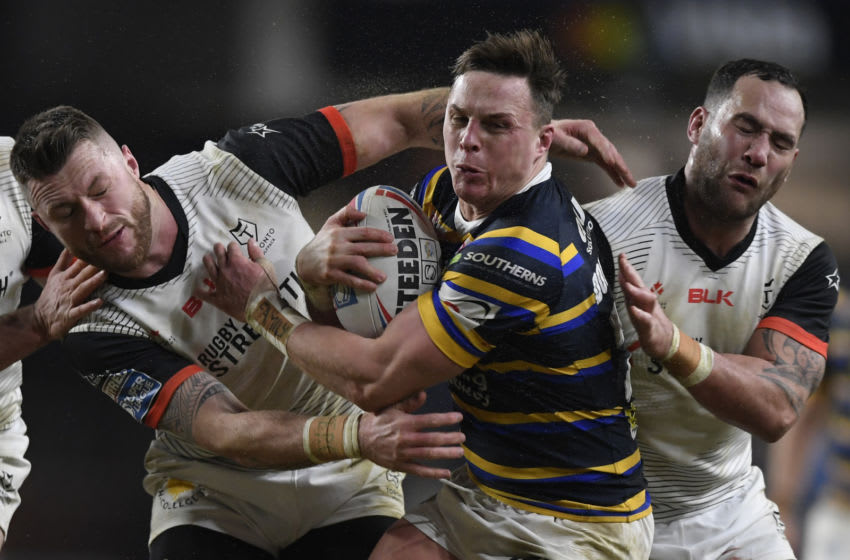 Richie Myler of Leeds Rhinos is tackled by the Toronto Wolfpack. (Photo by George Wood/Getty Images)