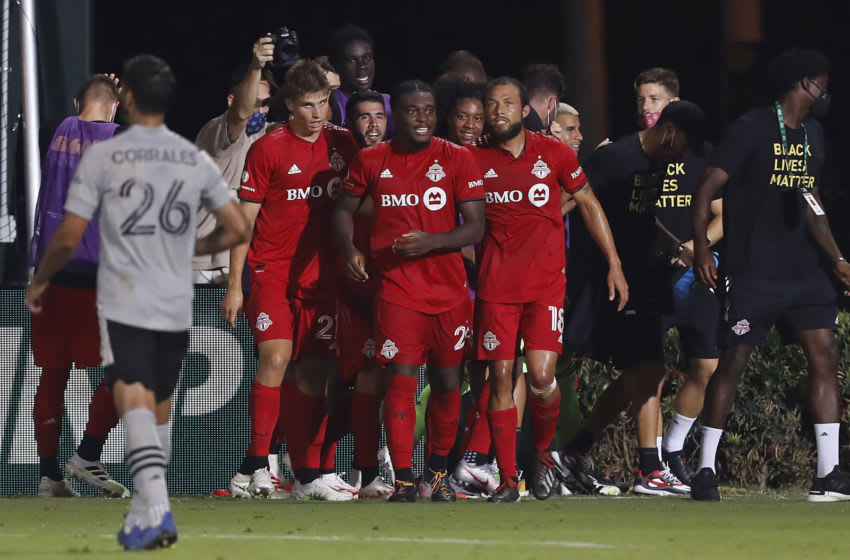 Ayo Akinola #20 of Toronto FC celebrates with teammates. (Photo by Michael Reaves/Getty Images)