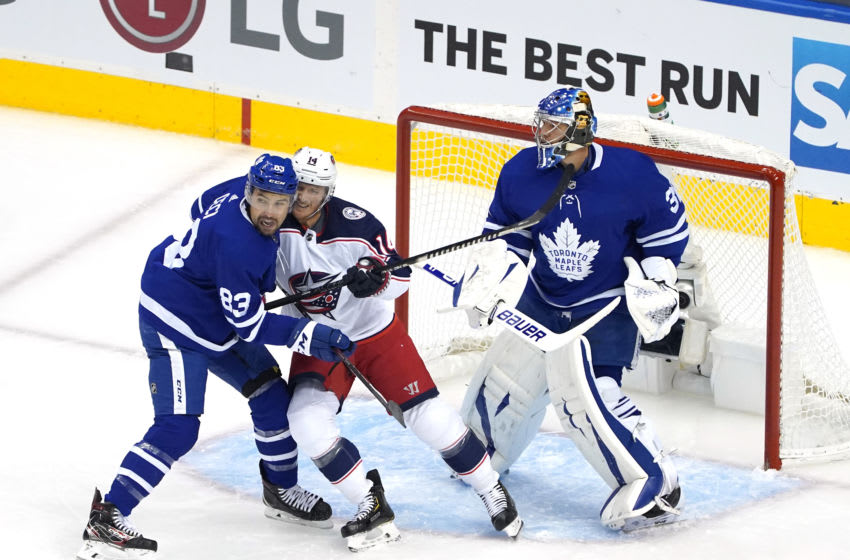 Cody Ceci #83 of the Toronto Maple Leafs shoves Gustav Nyquist #14 of the Columbus Blue Jackets. (Photo by Andre Ringuette/Freestyle Photo/Getty Images)
