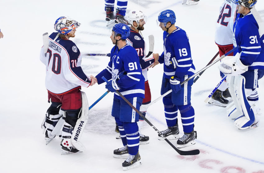 Joonas Korpisalo #70 and Nick Foligno #71 of the Columbus Blue Jackets shake hands with John Tavares #91 and Jason Spezza #19 of the Toronto Maple Leafs. (Photo by Andre Ringuette/Freestyle Photo/Getty Images)
