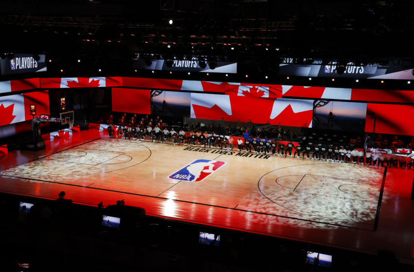 Players take a knee during the Canadian national anthem before the start of a game between the Brooklyn Nets and the Toronto Raptors. (Photo by Kevin C. Cox/Getty Images)