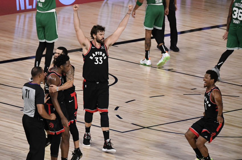 Marc Gasol #33 of the Toronto Raptors and Kyle Lowry #7 of the Toronto Raptors react after their win over Boston Celtics in Game Three of the Eastern Conference Second Round. (Photo by Douglas P. DeFelice/Getty Images)