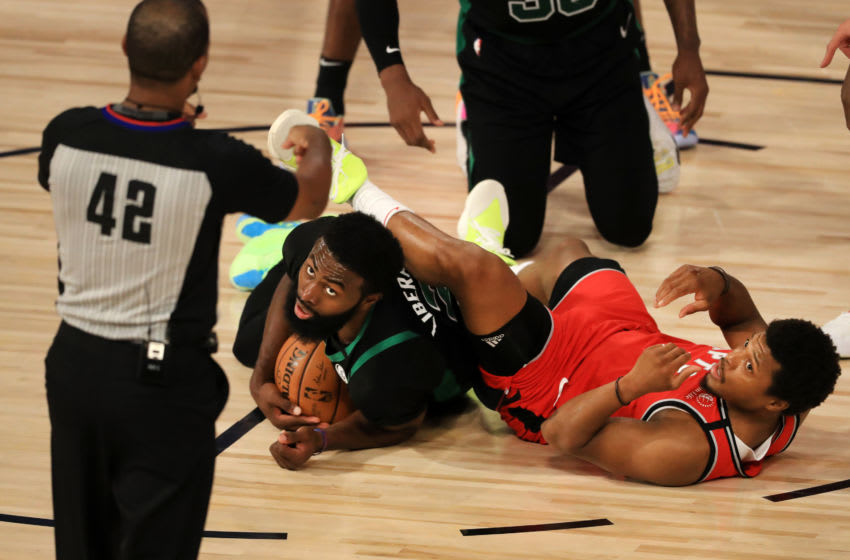 Kyle Lowry #7 of the Toronto Raptors and Jaylen Brown #7 of the Boston Celtics on the floor. (Photo by Mike Ehrmann/Getty Images)