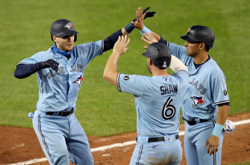 Danny Jansen #9 of the Toronto Blue Jays celebrates with teammates Travis Shaw #6 and Joe Panik #2 after hitting a grand slam. (Photo by Bryan M. Bennett/Getty Images)
