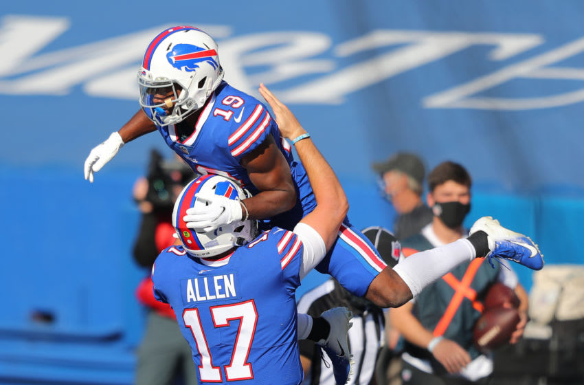 Josh Allen #17 celebrates with Isaiah McKenzie #19 of the Buffalo Bills. (Photo by Timothy T Ludwig/Getty Images)