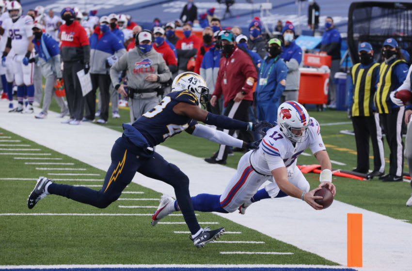 Josh Allen #17 of the Buffalo Bills scores a touchdown during the third quarter against the Los Angeles Chargers. (Photo by Timothy T Ludwig/Getty Images)