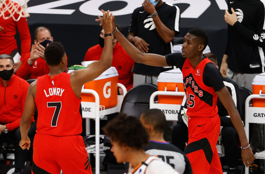 Chris Boucher #25 of the Toronto Raptors high fives Kyle Lowry #7. (Photo by Christian Petersen/Getty Images)