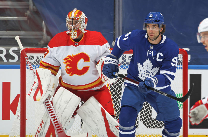 John Tavares #91 of the Toronto Maple Leafs looks for a puck to re-direct against David Rittich #33 of the Calgary Flames. (Photo by Claus Andersen/Getty Images)