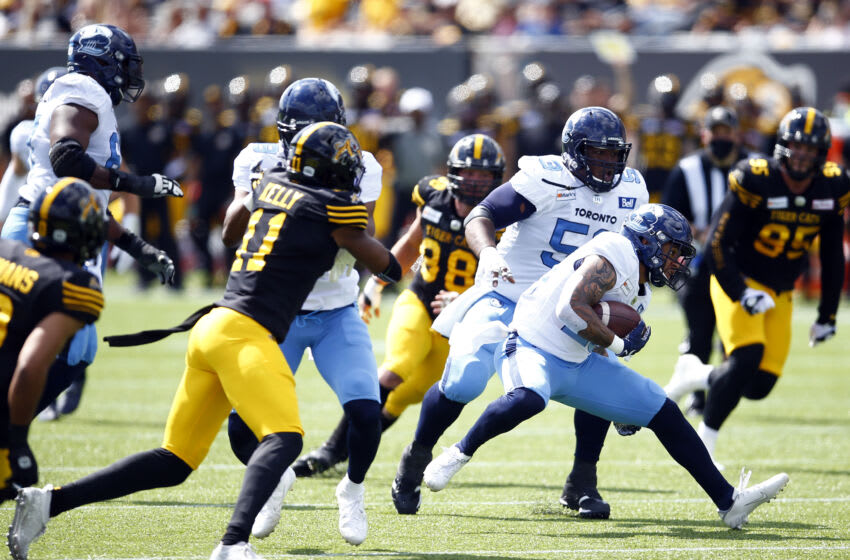 D.J. Foster #29 of the Toronto Argonauts runs with the ball during a CFL game against the Hamilton Tiger-Cats. (Photo by Vaughn Ridley/Getty Images)
