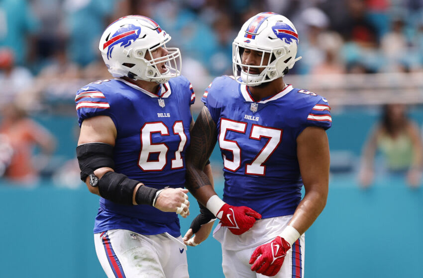 Justin Zimmer #61 and A.J. Epenesa #57 of the Buffalo Bills celebrate after sacking Tua Tagovailoa #1 of the Miami Dolphins. (Photo by Michael Reaves/Getty Images)
