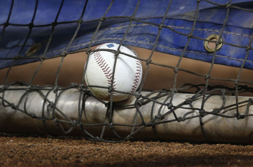 A baseball lays in the batting cage before the Chicago White Sox game against the Toronto Blue Jays. (Photo by Tom Szczerbowski/Getty Images)