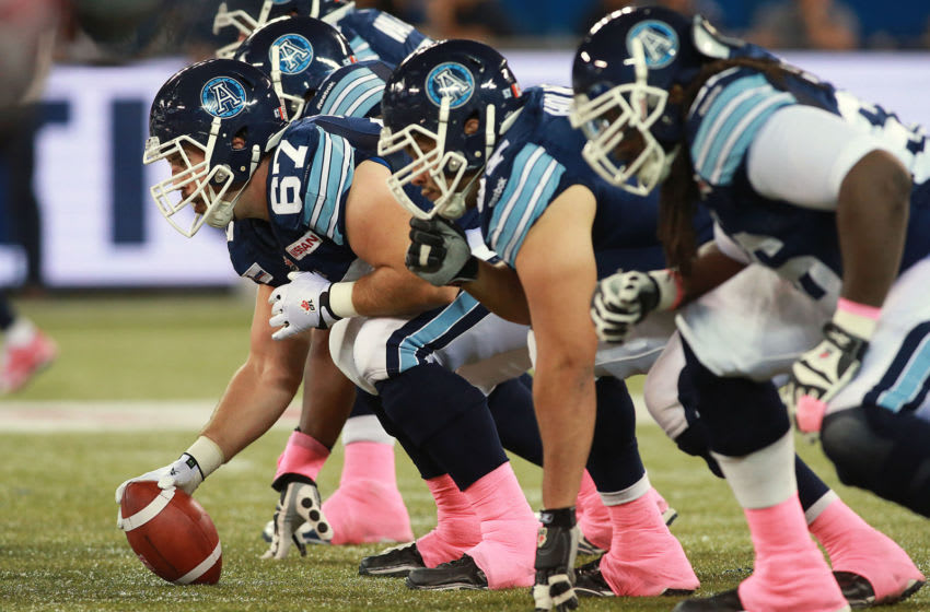 Members of the Toronto Argonauts wear pink tape in support of women's cancer awareness in the month of October. (Photo by Dave Sandford/Getty Images)